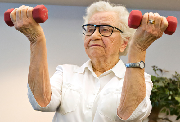 Ethel exercises with two three pound weights